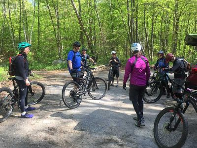 Mountain bikers gathering for skills clinic