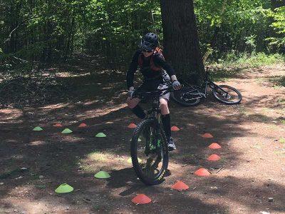 Mountain biker practicing tight turns