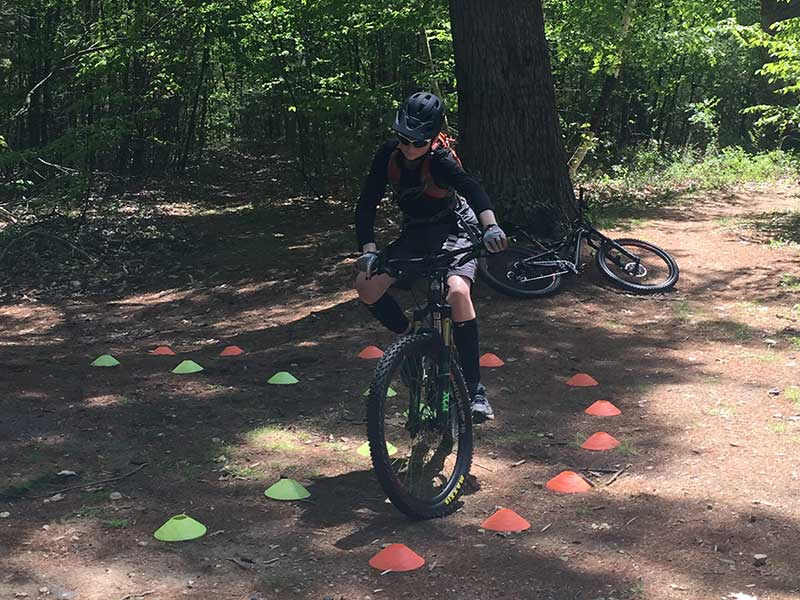 Mountain biker practicing tight turns