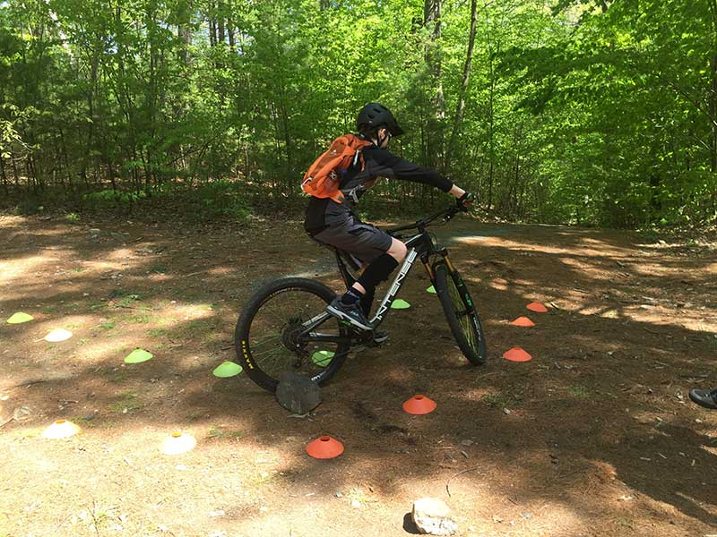 Mountain biker riding trail of cones