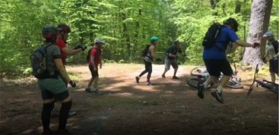 Mountain bike clinic participants practicing technique off their bikes