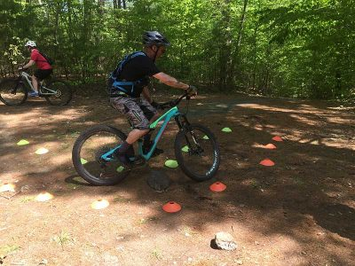 Mountain biker practicing tight turn with obstacle